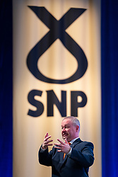 Edinburgh, Scotland, UK. 28 April, 2019. Day 2 of thee SNP ( Scottish National Party) Spring Conference takes place at the EICC ( Edinburgh International Conference Centre) in Edinburgh. Pictured; Man signing for the deaf during a speech at the conference