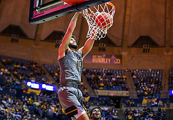 Jan 14, 2020; Morgantown, West Virginia, USA; West Virginia Mountaineers guard Jermaine Haley (10) dunks the ball during the second half against the TCU Horned Frogs at WVU Coliseum. Mandatory Credit: Ben Queen-USA TODAY Sports