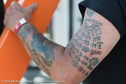 An armful of Sturgis tattoos recounts Gene Stone's past rallies at the annual Sturgis Black Hills Motorcycle Rally.  SD, USA.  August 12, 2016.  Photography ©2016 Michael Lichter.