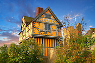 """The half timbered gate house  built in the 1280s, the  finest fortified medieval manor house in England, Stokesay Castle, Shropshire, England . Stokesay Castle is one of the finest surviving fortified manor houses in England, and situated at Stokesay in Shropshire. It was largely built in its present form in the late 13th century by Laurence de Ludlow, on the earlier castle. Architecturally, Stokesay Castle is """"one of the best-preserved medieval fortified manor houses in England"""", according to historian Henry Summerson.[1] The castle comprises a walled, moated enclosure, with an entrance way through a 17th-century timber and plaster gatehouse. Inside, the courtyard faces a stone hall and solar block, protected by two stone towers. The hall features a 13th-century wooden-beamed ceiling, and 17th-century carved figures ornament the gatehouse and the solar. <br /> <br /> Visit our MEDIEVAL PHOTO COLLECTIONS for more   photos  to download or buy as prints https://funkystock.photoshelter.com/gallery-collection/Medieval-Middle-Ages-Historic-Places-Arcaeological-Sites-Pictures-Images-of/C0000B5ZA54_WD0s"""