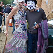 A fancy dressed lady and with an Anonymous activist. Thousands turned out for a march of solidarity against fracking in Balcombe. The village Balcombe in Sussex is the  centre of fracking by the company Cuadrilla. The march saw anti-fracking movements from the Lancashire and the North, Wales and other communities around the UK under threat of gas and oil exploration by fracking.