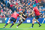 Viliame Mata (#8) of Edinburgh Rugby charges at John Ryan (#3) and Tadhg Beirne (#5) of Munster Rugby during the Heineken Champions Cup quarter-final match between Edinburgh Rugby and Munster Rugby at BT Murrayfield Stadium, Edinburgh, Scotland on 30 March 2019.