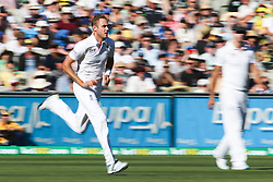 © Licensed to London News Pictures. 27/12/2013. Stuart Broad runs into  ball during Day 2 of the Ashes Boxing Day Test Match between Australia Vs England at the MCG on 27 December, 2013 in Melbourne, Australia. Photo credit : Asanka Brendon Ratnayake/LNP
