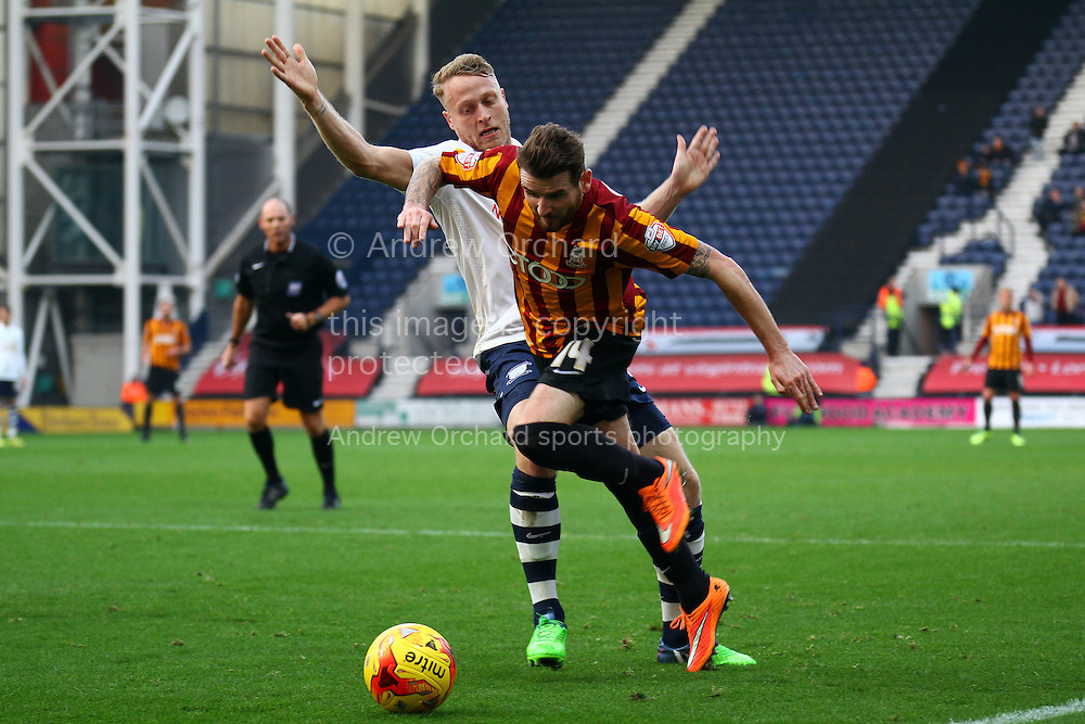 Preston North End's Tom Clarke looks to tackle Bradford City's Mark Yeates. Skybet football league one match, Preston North End v Bradford city at Deepdale in Preston, Lancs on Saturday 15th November 2014.<br /> pic by Chris Stading, Andrew Orchard sports photography.