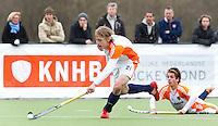 AERDENHOUT - 08-04-2012 -  Floris Molenaar aan de bal , zondag tijdens de wedstrijd tussen Nederland Jongens A en Spanje Jongens A (4-1) , tijdens het Volvo 4-Nations Tournament op de velden van Rood-Wit in Aerdenhout. Op de grond Hidde Pfijffer. FOTO KOEN SUYK