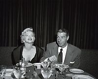 1954 Marilyn Monroe and Joe DiMaggio dine at the Mocambo Nightclub on Sunset Blvd.