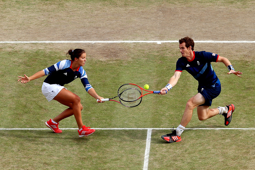 LONDON, ENGLAND - AUGUST 04:  Laura Robson and Andy Murray of Great Britain compete against Christopher Kas and Sabine Lisicki of Germany in their Mixed Doubles Tennis semifinal match on Day 8 of the London 2012 Olympic Games at the All England Lawn Tennis and Croquet Club on August 4, 2012 in London, England.  (Photo by Elsa/Getty Images)