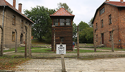 A guard tower and barracks surrounded by barbed wire fences at the Auschwitz-Birkenau Nazi concentration camps in Auschwitz, Poland on September 3, 2017. Auschwitz concentration camp was a network of German Nazi concentration camps and extermination camps built and operated by the Third Reich in Polish areas annexed by Nazi Germany during WWII. It consisted of Auschwitz I (the original camp), Auschwitz II–Birkenau (a combination concentration/extermination camp), Auschwitz II–Monowitz (a labor camp to staff an IG Farben factory), and 45 satellite camps. In September 1941, Auschwitz II–Birkenau went on to become a major site of the Nazi Final Solution to the Jewish Question. From early 1942 until late 1944, transport trains delivered Jews to the camp's gas chambers from all over German-occupied Europe, where they were killed en masse with the pesticide Zyklon B. An estimated 1.3 million people were sent to the camp, of whom at least 1.1million died. Around 90 percent of those killed were Jewish; approximately 1 in 6 Jews killed in the Holocaust died at the camp. Others deported to Auschwitz included 150,000 Poles, 23,000 Romani and Sinti, 15,000 Soviet prisoners of war, 400 Jehovah's Witnesses, and tens of thousands of others of diverse nationalities, including an unknown number of homosexuals. Many of those not killed in the gas chambers died of starvation, forced labor, infectious diseases, individual executions, and medical experiments. In 1947, Poland founded a museum on the site of Auschwitz I and II, and in 1979, it was named a UNESCO World Heritage Site. Photo by Somer/ABACAPRESS.COM