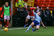Accrington Stanley midfielder Sam Finley (14) tackles Charlton Athletic midfielder Tariqe Fosu-Henry (11) during the EFL Sky Bet League 1 match between Charlton Athletic and Accrington Stanley at The Valley, London, England on 19 January 2019.