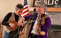 """Fiddler Ellen Carlson accompanied by Tim Mowry on guitar entertains visitors to the Gilford Library with two renditions of """"Stay All Night Don't Want to Go Home""""  along with Irish, Scottish, Bluegrass and Jazz fiddling tunes on Thursday evening.  (Karen Bobotas/for the Laconia Daily Sun)"""