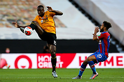 Willy Boly of Wolverhampton Wanderers clears the ball from Andros Townsend of Crystal Palace - Mandatory by-line: Robbie Stephenson/JMP - 20/07/2020 - FOOTBALL - Molineux - Wolverhampton, England - Wolverhampton Wanderers v Crystal Palace - Premier League