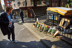 © Licensed to London News Pictures. 11/06/2015. London, UK. Flowers and notes left at a scene where a 17-year-old boy was stabbed to death in Caldy Walk, Islington, north London. Photo credit: Tolga Akmen/LNP