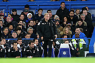 Eddie Howe, the Bournemouth manager looks on from the dugout. Barclays Premier league match, Chelsea v AFC Bournemouth at Stamford Bridge in London on Saturday 5th December 2015.<br /> pic by John Patrick Fletcher, Andrew Orchard sports photography.