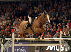 Britain's Laura Renwick riding Top Dollar VI competes in the Christmas Masters during day five of the London International Horse Show at London Olympia. PRESS ASSOCIATION Photo. Picture date: Saturday December 16, 2017. See PA story EQUESTRIAN Olympia. Photo credit should read: Steve Parsons/PA Wire