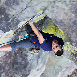 Kyle Wall leading Fish Ladder, 5.11b at Paradise Valley in Squamish, BC during the Arcteryx Photo Shootout.