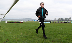 Jockey Alan Johns warms up before his ride during the Coral Welsh Grand National day at Chepstow Racecourse.
