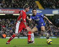 Photo: Lee Earle.<br /> Chelsea v Middlesbrough. The Barclays Premiership.<br /> 03/12/2005. Chelsea's Frank Lampard (R) gets his foot to the ball ahead of Frank Queqdrue.