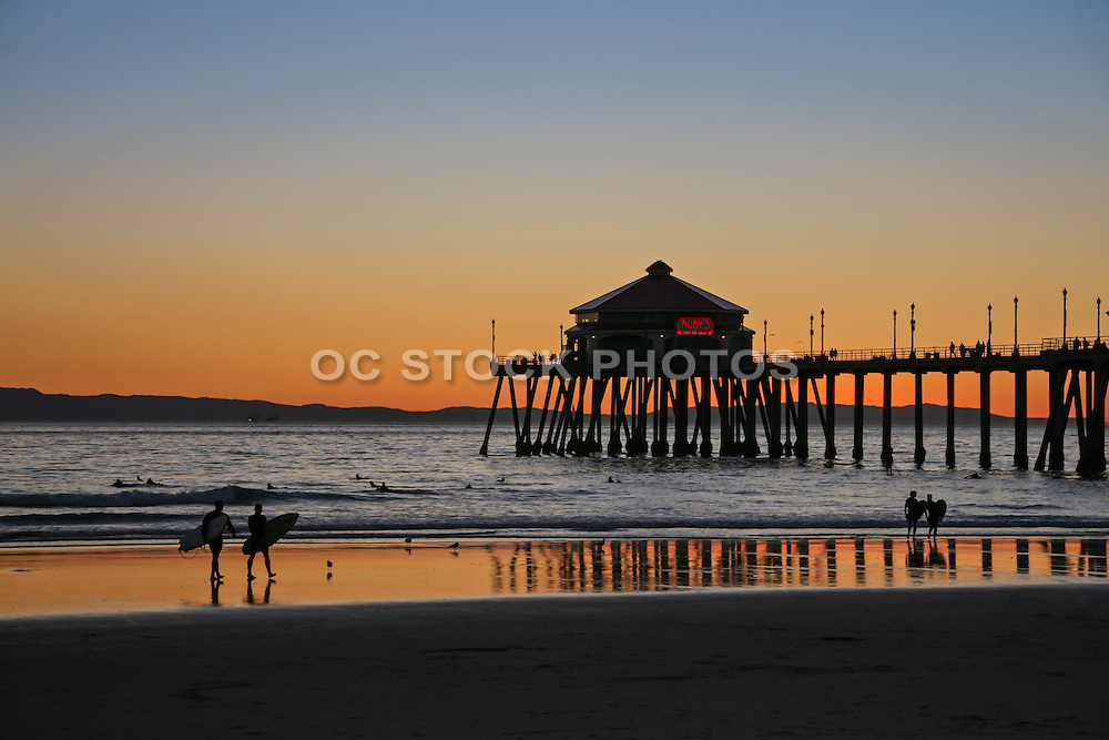 Surfers at Huntington Beach Pier at Sunset
