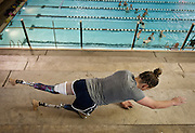 Lehi High School swimmer Amy Chapman does a core workout during dry land practice at the Lehi Legacy Center, Tuesday, Dec. 18, 2012. Chapman, 17, was born with fibular hemimelia and had both legs amputated when she was 13 months old.