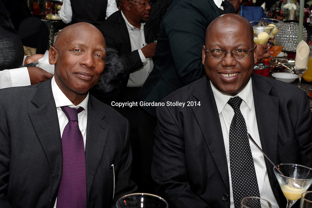 DURBAN - 8 August 2014 - Sam Kotane and Mike Mabuyakhlu share a light-hearted moment at the gala fund rasigin dinner of the Moses Kotane Institute, named of Sam Kotane's father, the former secretary general of the South African Communist Party. Mabuyakhulu is the KwaZulu-Natal MEC in charge of the Department of Economic Development and Tourism, which runs the Moses Kotane Institute. Picture: Allied Picture Press/APP