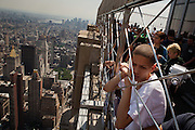 """NEW YORK, NY – MAY 25, 2011: Alex Rodriguez of Donegan Elementary School in Bethlehem stands atop the Empire State Building in New York City. <br /> <br /> In 2003, the Pew Hispanic Center released a report forecasting a dramatic shift in the population of Hispanic-American youth. According to the report, the number of American-born Hispanics in U.S. schools would double by 2020, and the rate of Hispanic births in the United States would soon """"outpace"""" immigration. <br /> <br /> By 2010, schools in Eastern Pennsylvania's Lehigh Valley already embodied this fundamental shift. On May 25, 2011, children in the Leadership program at Donegan Elementary School traveled to New York City for a field trip. Walking under, over, inside and on top of America's iconic structures, the group of predominantly second and third generation Hispanic children experienced for the first time the city to which many of their families immigrated decades before. This burgeoning generation is like a bridge between cultures - the City a backdrop on which they explore their new American identity."""