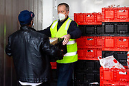 Bill Shorten (right) is seen inside a large freezer as he helps unload a truck full of meat from Macca Halal Foods for the residents of the Alfred Street housing commission tower during COVID-19 on 10 July, 2020 in Melbourne, Australia. Former Federal Labor Leader Bill Shorten, along with close allies at Trades Hall help deliver Halal meat, supplied by Macca Halal Foods to the locked down housing commission towers following a coronavirus outbreak detected inside the complex. Mr Shorten was able to use his high profile to ensure food was not turned away by police so that it would reach the residents inside. (Photo be Dave Hewison/ Speed Media)