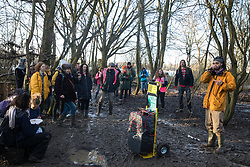 Harefield, UK. 18 January, 2020. Earth protector and Stop HS2 activist Freeman performs by way of a thank you to activists from Extinction Rebellion, Stop HS2 and Save the Colne Valley who reoccupied the Colne Valley wildlife protection camp where he had until recently been living on the second day of a three-day 'Stand for the Trees' protest in the Colne Valley timed to coincide with tree felling work by HS2. Bailiffs acting for HS2 have been evicting Stop HS2 activists from the camp for the past week and a half. 108 ancient woodlands are set to be destroyed by the high-speed rail link.