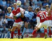 Photo: Richard Lane.<br />Coventry City v Rotherham United. Nationwide Division One. 24/04/2004.<br />Eric Deloumeaux clears as John Mullins challenges.