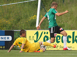 22.06.2012, Sportplatz SK Kammer, Kammer, AUT, 1. FBL, Testspiel, SV Josko Ried vs MSK Zilina, im Bild Stanislav Angelovic, (MSK Zilina, #2) und Marco Meilinger, (Sv Josko Ried, #16)// Stanislav Angelovic, (MSK Zilina, #2) and Marco Meilinger, (Sv Josko Ried, #16) during Preparation Game for the 1. FBL between SV Josko Ried and MSK Zilina at the Sportplatz SK Kammer, Kammer, Austria on 2012/06/22 . EXPA Pictures © 2012, PhotoCredit: EXPA/ R. Hackl