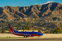 Southwest Airlines 737 at Hollywood Burbank Airport, with Verdugo Mountains behind, Los Angeles, California USA.