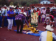 Godfather, Glenn Cromwell painting Carla Goseyun, Carla Goseyun's White Mountain Apache Traditional Sunrise Ceremony, Whiteriver, Arizona.  Please Note: A small extra licensing fee needs to be paid to the Goseyun Family for usage of this photo. Contact Fred Hirschmann for more information. Thanks.