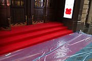 Red lips for the opera the Mikado and a rain-soaked red carpet that awaits crowds seeing the English National Operas opening night of Orpheus and Eurydice at the Coliseum on St. Martins Lane, on 1st October 2019, in London, England.