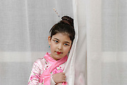 Young girl of 8 dressed up as a Chinese woman