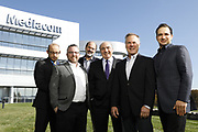 SHOT 10/31/18 11:34:56 AM - Mediacom Communications Corporation is a cable television and communications provider headquartered in Chester, New York. Founded in 1995 by Rocco B. Commisso, it serves primarily smaller rural markets in the Midwest and Southern United States. In the group photo Mediacom's Jack Griffin, Mark Stephan, Tom Larsen, Ruben Martino, Rocco Commisso and CoBank RM Gary Franke. (Photo by Marc Piscotty © 2018)