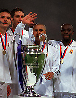 Fotball<br /> Real Madrid Feature<br /> Foto: Colorsport/Digitalsport<br /> NORWAY ONLY<br /> <br /> (L>R) Fernando Moientes, Ivan Helguera, Roberto Carlos and Claude Makelele (Real) wait to lift the European Cup. Real Madrid v Bayer Leverkusen. The European Champions League Cup Final. Hampden Park, 15/5/02