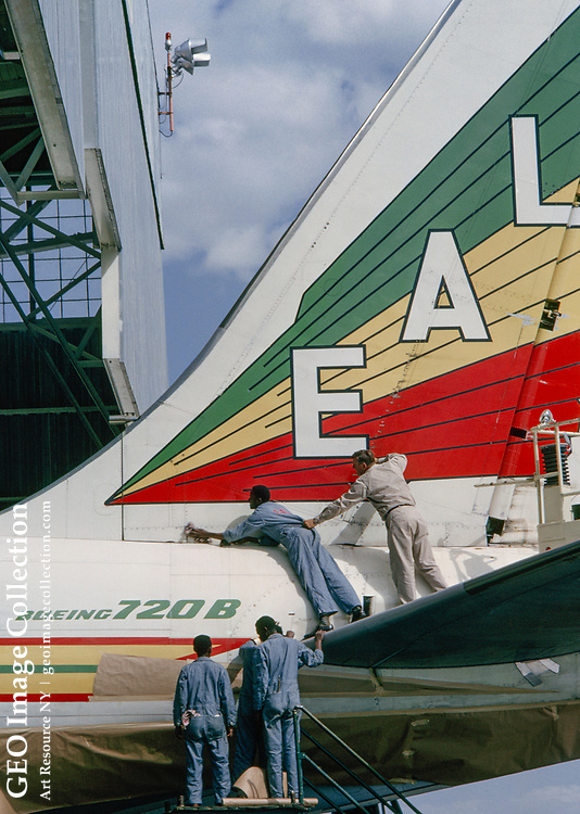 A ground crew inspects a jetliner bound for Europe.