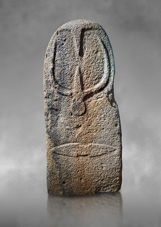 Late European Neolithic prehistoric Menhir standing stone with carvings on its face side. The representation of a stylalised male figure starts at the top with a long nose from which 2 eyebrows arch around the top of the stone. below this is a carving of a falling figure with head at the bottom and 2 curved arms encircling a body above. at the bottom is a carving of a dagger running horizontally across the menhir. Excavated from Bau Carradore II, Laconi. Menhir Museum, Museo della Statuaria Prehistorica in Sardegna, Museum of Prehoistoric Sardinian Statues, Palazzo Aymerich, Laconi, Sardinia, Italy .<br /> <br /> Visit our PREHISTORIC PLACES PHOTO COLLECTIONS for more photos to download or buy as prints https://funkystock.photoshelter.com/gallery-collection/Prehistoric-Neolithic-Sites-Art-Artefacts-Pictures-Photos/C0000tfxw63zrUT4