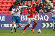 Charlton Athletic attacker Lyle Taylor (9) taking on Rochdale defender Ryan Delaney (5) during the EFL Sky Bet League 1 match between Charlton Athletic and Rochdale at The Valley, London, England on 4 May 2019.