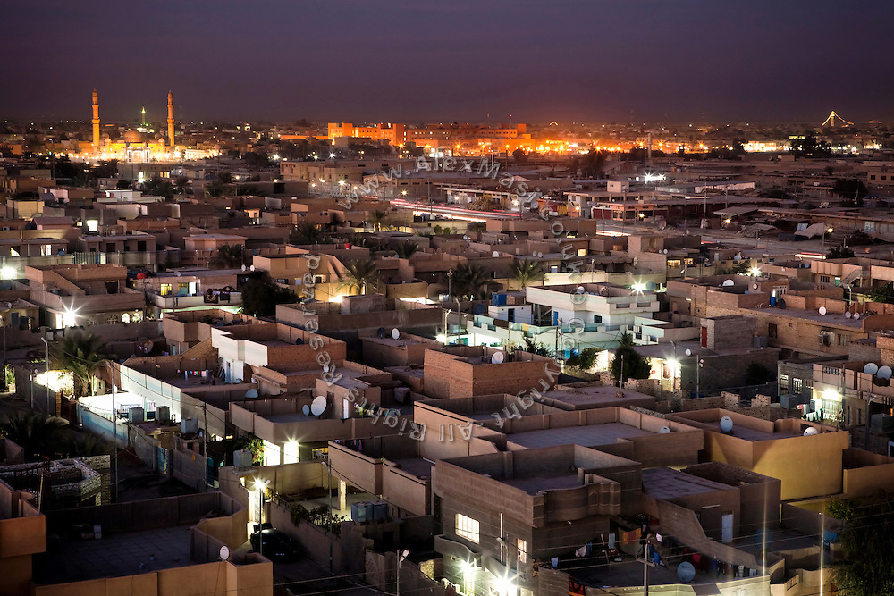 The Fallujah General Hospital, (top right) and the large Al-Khulafa Mosque (top left) are shining in orange lights during an early winter evening in Fallujah, Iraq. More then 15 per cent of children at the hospital are now being born with some sort of congenital defect. The average elsewhere in the world is believed to be between 2 and 4 per cent.