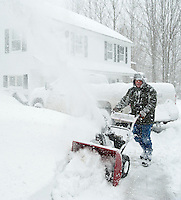 """Jerry Cotnoir starts snow blowing approximately 18"""" of new snow from his driveway on Liberty Hill in Gilford Wednesday afternoon as the Nor'Easter stormed through.   (Karen Bobotas/for the Laconia Daily Sun)"""