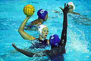 USA (white) -Puerto Rico women's water polo action at the 1999 Pan American Games.