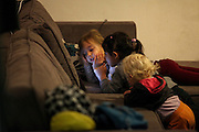 three Young girls are watching youtube film on an Ipad.