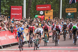 London, UK. 4 August, 2019. Elia Viviani of Deceuninck-Quick-Step wins the Prudential RideLondon Classic, Britain's only men's UCI WorldTour race and the richest one-day race in the world with a prize pot of 100,000 Euros on offer. This year's race features a redesigned race route from a start in Bushy Park in south-west London through Surrey, including a five-lap circuit of Box Hill, to a finish on the Mall.