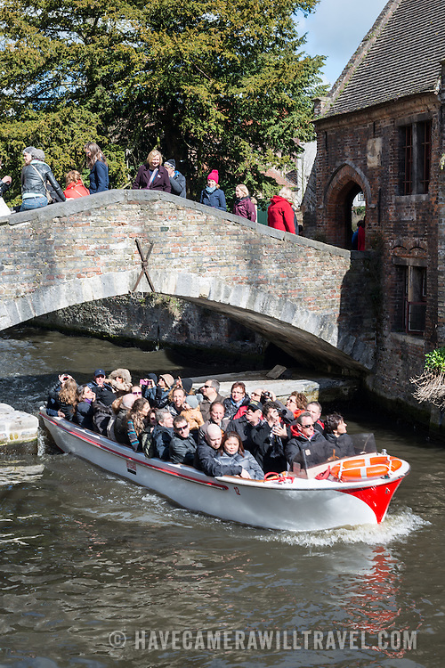 """Sometimes called """"The Venice of the North,"""" the historic Flemish city of Bruges has canals running through the old town. Before the water access became silted up, Bruges was a major commercial port."""