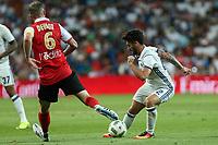 Stade de Reims's Devaux and Real Madrid's Isco during the XXXVII Bernabeu trophy between Real Madrid and Stade de Reims at the Santiago Bernabeu Stadium. August 15, 2016. (ALTERPHOTOS/Rodrigo Jimenez)