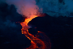 Handout photo of Early morning view of Fissure 8. Lava roils and pours out of the spatter cone into the open channel. Kilauea Volcano, HI, USA, June 28, 2018. Photo by USGS via ABACAPRESS.COM