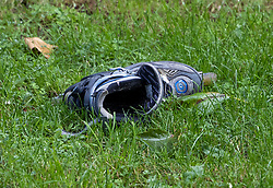 © Licensed to London News Pictures. 06/07/2021. London, UK. A shoe lies abandoned on the ground at a housing estate off Oval Place in south London where a 16 year old boy was stabbed to death last night. Police were called at around 23:45hrs on Monday, 5 July, to a teenager stabbed in Oval Place, SW8. Officers attended along with London Ambulance Service. The 16-year-old male was pronounced dead at the scene. Photo credit: Peter Macdiarmid/LNP