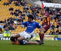 Photo. Glyn Thomas.<br /> Bradford v Ipswich. Nationwide Division 1.<br /> Bradford & Bingley Stadium, Bradford. 11/10/03.<br /> Bradford's keeper Marlon Beresford (L) advances to save a shot from Pablo Counago (C).