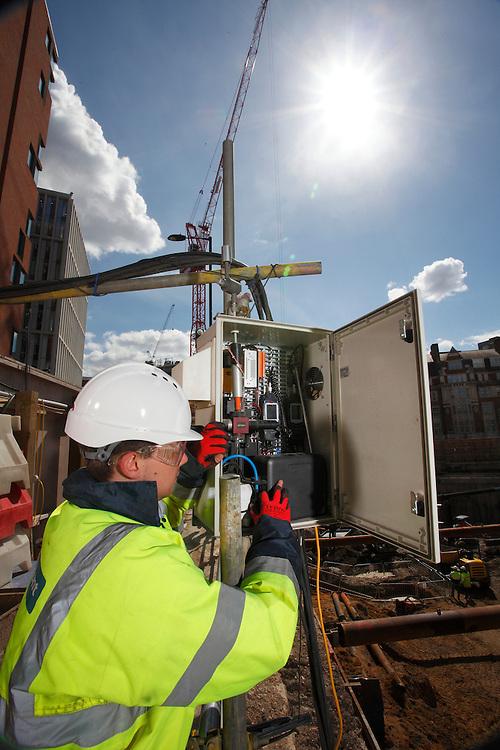 Engineer using sound and vibration monitoring equipment. 145 City Road.<br /> John F Hunt Demolition. <br /> Photo: Zute Lightfoot / lightfootconstructionphotography.com