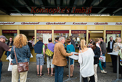 Famous currywurst kiosk Konnopke's Imbiss in bohemian Prenzlauer Berg district of Berlin Germany